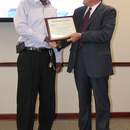Zieburtz presents the Platinum Award for the Rocky Creek Plant to MWA Manager of Wastewater Operations Larry Reynolds.