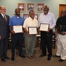GAWP President Bill Zieburtz (left) with MWA award winners Jarvis Fennelle, William Brown, Larry Reynolds, and Gary McCoy.