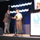 Gary McCoy (left), MWA Director of Water Operations, accepts the first GAWWA Champion of Diversity Award.