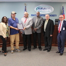 The MWA Board of Directors honored Mike Mixter (center) upon his retirement for 17 years of dedicated and distinguished service to the Authority and its customers.