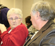 Randy Smith (right) chats with his wife before the January MWA board meeting in which he received a Resolution honoring his retirement.