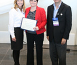 Heather Veal (center), CMOM Coordinator for the MWA, accepts the GAWP Collection System Gold Award on behalf of the Authority, for the utility's grade of 95% or higher on a recent industry audit.
